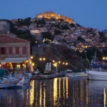 Molyvos Port at night with the Byzantine Fort perched above