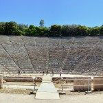 Epidavros. The trees behind the theatre were an important part of the design in Greek amphitheatres and a feature that was not present in subsequent Roman designs.