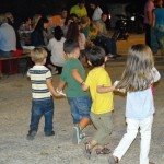 Kids dance at a church fete